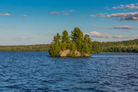 An amazing landcape of the nature containing a lake and a beautiful blue sky. The wild nature of Ontario, Canada. photo