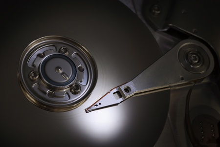 close up of hard disk with spot reflection   photo