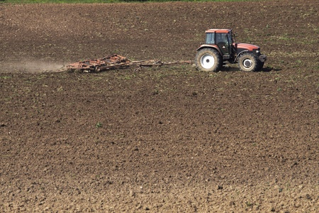 tillage: Tractor plowing the field