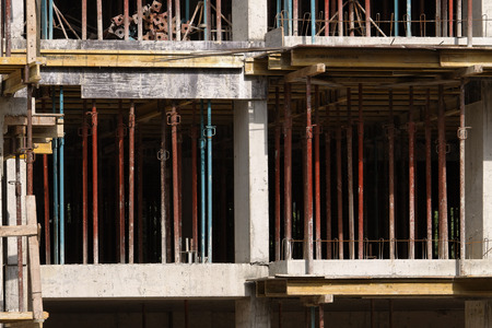 erecting: Building under construction with scaffolding Stock Photo