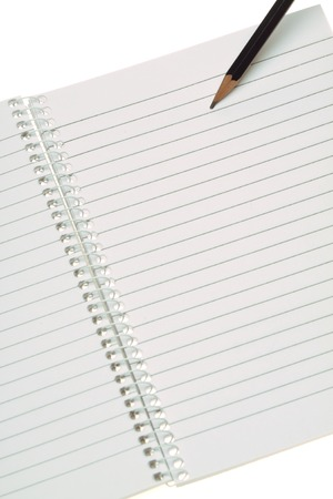 open notebook: Pencil on a open notebook with spiral