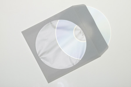 CD dvd blue ray with paper case isolated on a white background photo