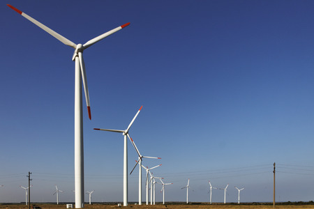 electric generating plant: Photo of Wind power installation in sunny day Stock Photo