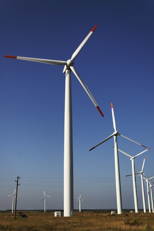 windpower: Photo of Wind power installation in sunny day Stock Photo