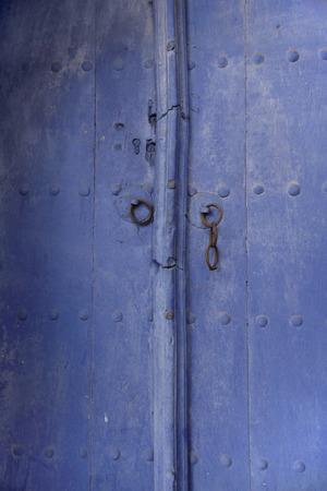 blue door: beautiful textured wooden old blue door, Bulgaria Stock Photo