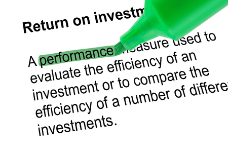 prominence: Highlighted word performance for Return on investment - ROI, with green pen over white paper. Isolated white background. Stock Photo