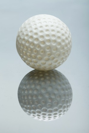 mirrored: white Mini Golf ball on mirrored background Stock Photo