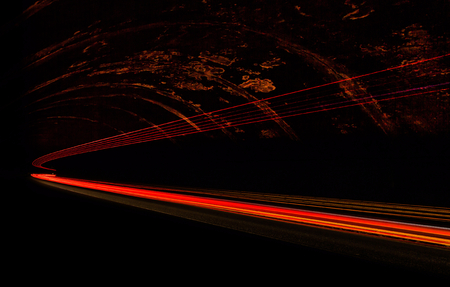architecture and buildings: Car light trails in the tunnel. Long exposure photo taken in a tunnel below Veliko Tarnovo Stock Photo