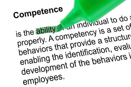 prominence: Highlighted word ability for Competence with green pen over white paper. Isolated white background.