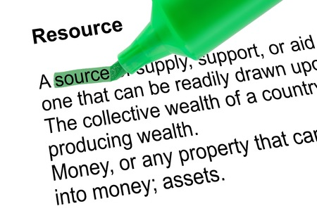 Highlighted word source for Resource with green pen over white paper. Isolated white background.