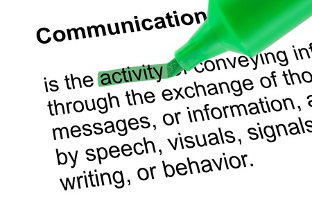 prominence: Highlighted word activity for Communication with green pen over white paper. Isolated white background.