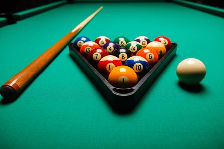 billiards cue: Billiard balls in a pool table. Stock Photo