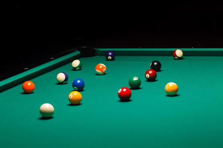 9 ball billiards: Billiard balls in a pool table. Stock Photo