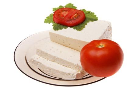 bulgarian: Original bulgarian cheese with tomato into plate Stock Photo