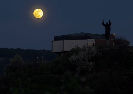veliko tarnovo: Aula of the University of Veliko Tarnovo at night with a bright full moon
