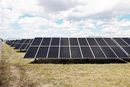 Power plant using renewable solar energy with light sky 写真素材