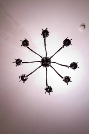 chandelier background: Simple chandelier and fire detector bottom view with white ceiling background Stock Photo