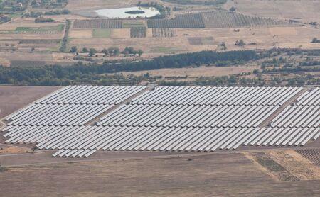 photovoltaic: Aerial photo of solar power plant. Many solar energy panels in countryside from above. Photovoltaic power station near Kazanlak, Bulgaria, European union. Stock Photo