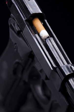munition: cigarette burned like a bullet in the barrel of a gun Stock Photo
