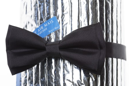 air mail: a black bow-tie with label air mail