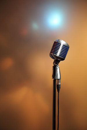 retro microphone: Stylish retro microphone on a colored blurred  background