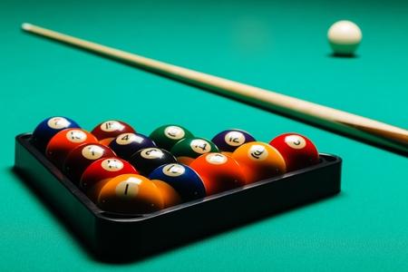 9 ball billiards: Billiard balls in a pool table, closeup