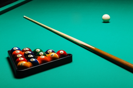 billiards hall: Billiard balls in a pool table, closeup