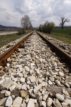 ballast: empty railway  through field and three closeup Stock Photo