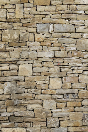 paper screens: old wall in stones closeup