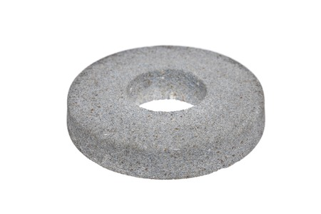 drudgery: Circular abrasive disk  - emery isolated on white background Stock Photo
