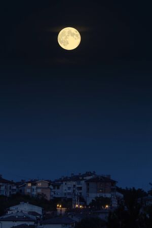 veliko: Huge white tinted moon over Veliko Tarnovo Bulgaria