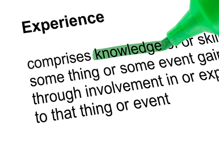lexicographer: Highlighted word knowledge to Experience with green pen over paper. Isolated white background.