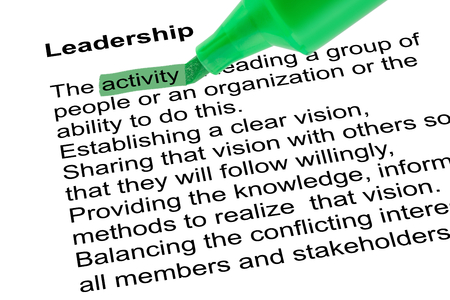 Highlighted word activity for Leadership with green pen over white paper. Isolated white background.