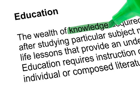 lexicographer: Highlighted word knowledge for Education with green pen over white paper. Isolated white background.