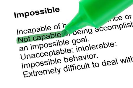 흰 종이 위에 녹색 펜으로 불가능에 대한 아니 할 강조 표시된 단어. 격리 된 흰색 배경. 스톡 콘텐츠