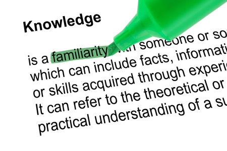 lexicographer: Highlighted word familiarity for Knowledge with green pen over white paper. Isolated white background. Stock Photo