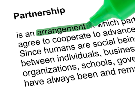 lexicographer: Highlighted word arrangement for Partnership with green pen over white paper. Isolated white background. Stock Photo