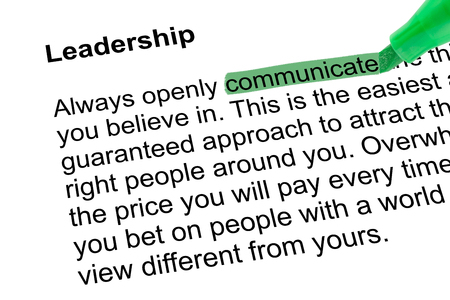 lexicographer: Highlighted word communicate for Leadership with green pen over white paper. Isolated white background. Stock Photo