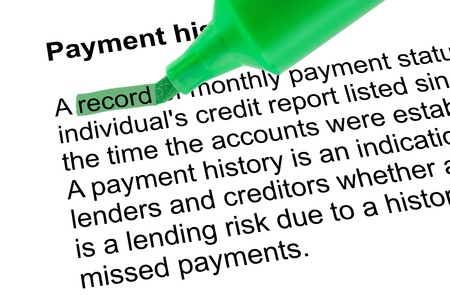 Highlighted word record for Payment historywith green pen over white paper. Isolated white background. 写真素材