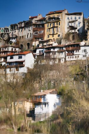 tarnovo: Reflection in the water of river Yantra Veliko Tarnovo