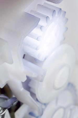 interlink: toothed mechanism in light shade, selective focus over gear