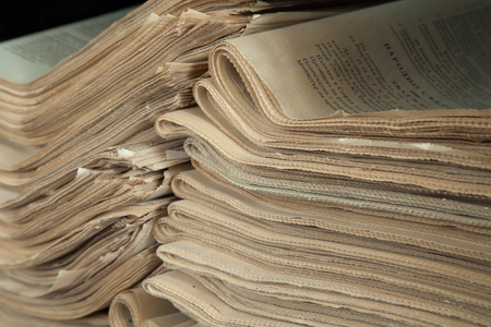 everyday jobs: A stack of old newspapers, old, fat yellow. Stock Photo