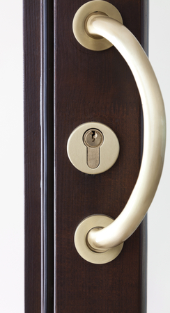 door lock: Close up  detail of an new style wooden door