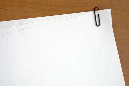 paper sheets: paper clip attached to multiple sheets of paper