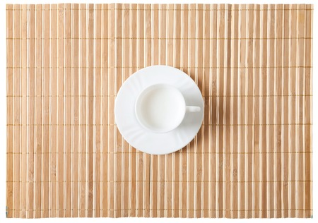 oriental rug: Close up of bamboo mat with old glasses isolated on white background Stock Photo