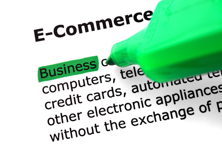 felt tip: The word e-commerce highlighted in green with felt tip pen Stock Photo