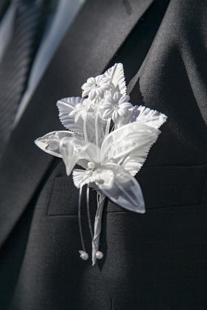 wedding boutonniere on suit of groom Stockfoto