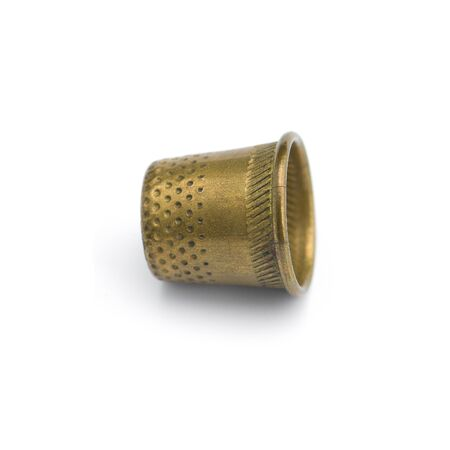 Old copper thimble close-up isolated on white background
