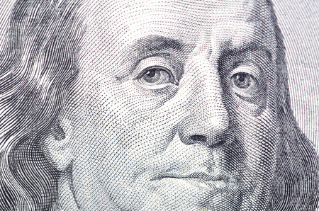 Macro close up of Ben Franklins face on the US $100 dollar bill