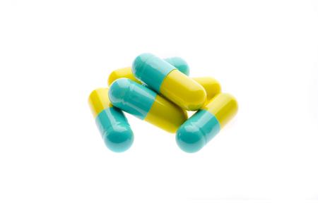 antibiotic pink pill: Pills on white background